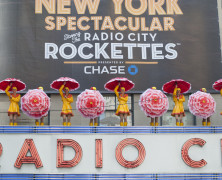 Radio City Rockettes Reveal NYC Banner Atop Marquee